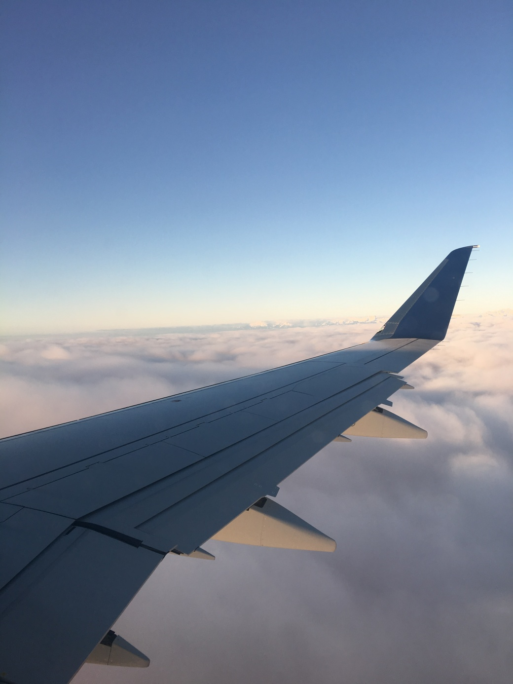 cliche-airplane-over-the-wing-photo